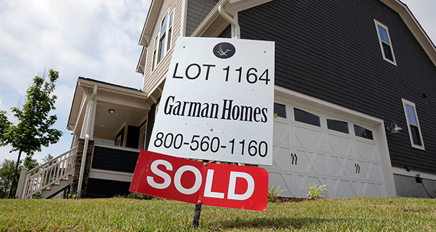 A sold sign is displayed June 9 in the yard of a newly built home in the Briar Chapel community in Chapel Hill, North Carolina. Standard & Poor reported Tuesday that its 20-city home price index rose 4.9 percent in April. (AP Photo: Gerry Broome)