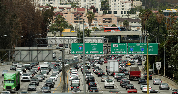 Traffic slowly moves along the 110 Freeway May 6 during afternoon rush hour in downtown Los Angeles. Within 30 years, the Department of Transportation projects, drivers will have to tolerate stop-and-go conditions or slow traffic for some period of each day on more than a third of U.S. highways. (AP Photo: Jae C. Hong)