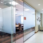 "Frosted glass on this conference room admits plenty of what architects call ""borrowed light"" while still providing privacy to attorneys and clients."