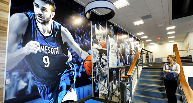 A photo mural of Timberwolves guard Ricky Rubio looks over the stairs between the first and second floors of the business office area in the new 107,000-square-foot Timberwolves and Lynx training center and headquarters in the Mayo Clinic Square building at 600 Hennepin Ave. in Minneapolis. (Staff photo: Bill Klotz)
