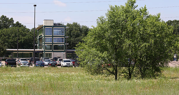 Coon Rapids city planners are in discussions with Minneapolis-based Sherman Associates on a potential apartment development with 300 units on vacant land immediately north of the Riverdale Station, a stop on the Northstar Commuter Rail line (background). (Staff photo: Bill Klotz)