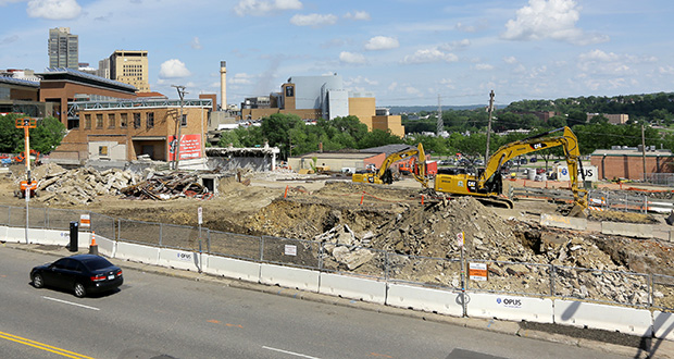 The former Seven Corners Hardware and Free At Last Church of God in Christ sites at 200 and 216 W. Seventh St. in St. Paul are nearly leveled. Construction of a new apartment building and hotel on the site should begin once the site is clear. (Staff photo: Bill Klotz)