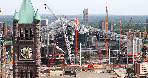 """The Vikings stadium in Minneapolis recently celebrated a """"topping out"""" event marking completion of structural concrete work, officials said Friday, Workers also completed a stormwater filtration system that will return filtered water to the watershed. (Staff photo: Bill Klotz)"""
