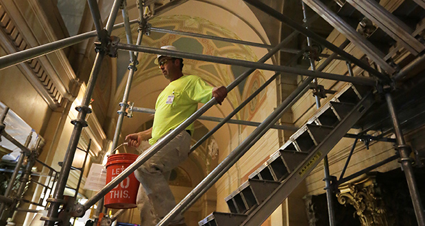 A worker descends scaffolding on the first level of the State Capitol in St. Paul. The $307 million Capitol renovation is picking up speed now that the legislative session is over. (Staff photo: Bill Klotz)