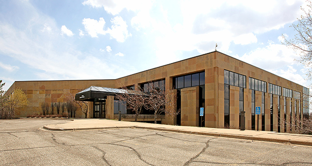 The 30-year-old office building at 2700 Lone Oak Parkway in Eagan once housed Northwest Airlines' headquarters. (Submitted photo: CoStar Group)