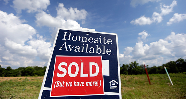 A sign indicates a site has been sold June 4 in a new home development in Nashville, Tennessee. The Commerce Department reported Friday that new-home sales slumped 6.8 percent last month. (AP Photo: Mark Humphrey)