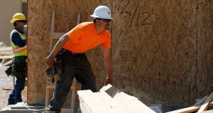 Construction workers work on a new large apartment complex April 16 in Scottsdale, Arizona. The National Association of Home Builders reported Monday that its builder sentiment index reached its highest level since November 2005. (AP Photo: Ross D. Franklin)