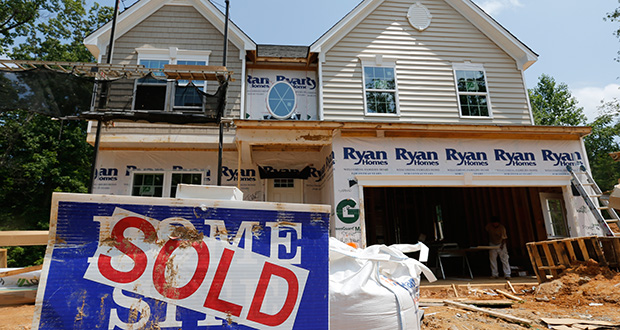 A sold sign is displayed June 8 outside a new home under construction in Mechanicsville, Virginia. The Commerce Department reported Tuesday that new-home sales rose 5.4 percent in July. (AP file photo)
