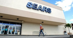 A woman walks into a Sears store in November 2012 in Hialeah, Florida. Sears reported Thursday its first quarterly profit in three years. (AP file photo)