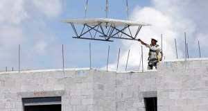 A construction worker works Aug. 17 on the site of the Landmark community, a group of condos and townhouses built by Lennar Homes, in Doral, Florida. The Commerce Department reported Tuesday that construction spending rose 0.7 percent in July. (AP Photo)