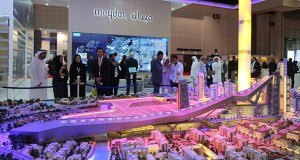 People visit the model of Meydan One, a $ 6.8 billionn development at the Cityscape Global exhibition on Sept. 8 Dubai, United Arab Emirates. A new ¾-mile ski slope will be part of a development recently launched by Dubai's ruler that promises to include the world's tallest residential tower and highest restaurant. (AP Photo)
