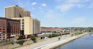 "The first portion of St. Paul's ""river balcony"" would be attached to the Custom House (the sand-colored building in this photo), a new development of 202 luxury apartments and a Hyatt Place Hotel in the former 17-story Post Office at 180 E. Kellogg Blvd. (Staff photo: Bill Klotz)"