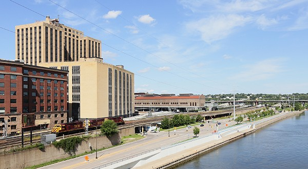 """The first portion of St. Paul's """"river balcony"""" would be attached to the Custom House (the sand-colored building in this photo), a new development of 202 luxury apartments and a Hyatt Place Hotel in the former 17-story Post Office at 180 E. Kellogg Blvd. (Staff photo: Bill Klotz)"""