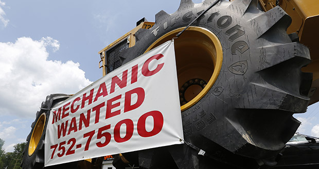 A help wanted sign is posted June 9 at a tractor dealership in Ashland, Virginia. Payroll processor ADP reported Wednesday that businesses added 200,000 jobs in September. (AP file photo)