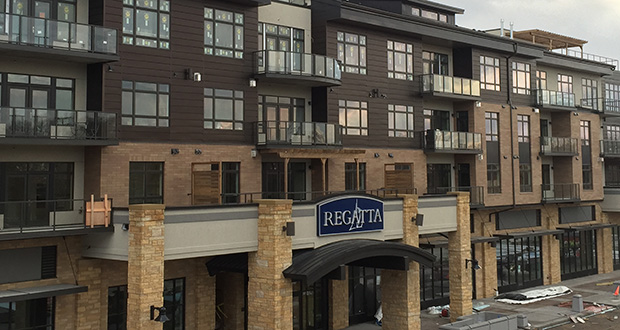 The last residents are finishing interior construction and moving into their condominiums at the 58-unit Regatta Wayzata Bay Residences, which welcomed its first residents in April. The building at 875 Lake St. N., is part of the Promenade of Wayzata, a $270 million mixed use project in downtown Wayzata. Submitted image: BohLand Development