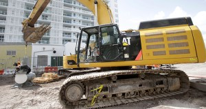 A Caterpillar 349E hydraulic excavator sits at a construction site Sept. 17 in Miami Beach, Florida. Caterpillar reported Thursday that its third quarter revenue fell short of expectations. AP file photo