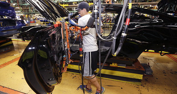 United Auto Workers assemblyman Justin Johnson works on a Ford Mustang on Aug. 20 at the Flat Rock Assembly Plant in Flat Rock, Michigan. Industrial production fell 0.1 percent in September, according to the Federal Reserve. AP Photo: Carlos Osorio