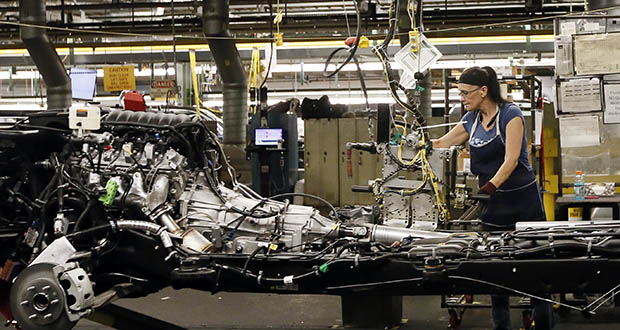 An employee works July 14 on the assembly line at the General Motors plant in Arlington, Texas. The Commerce Department reported Firday that U.S. factory orders dropped in August on a decline in commercial airplane demand. (AP file photo)