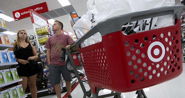 Boston College students Alli Urbon, left, and Eddie Dols shop Aug. 21 at the CityTarget store in Boston. The Commerce Department reported Wednesday that retail sales rose 0.1 percent in September. (AP File Photo)