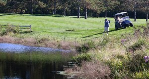 A golfer at Oneka Ridge Golf Course in Hugo avoids what appears to be a water trap, which actually is a collector of rainwater for irrigating the 900-acre course. It's part of the Rice Creek Watershed District project to reuse rainwater. (Staff photo: Bill Klotz)