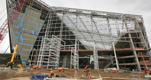 The west side of U.S. Bank Stadium is the only side not yet enclosed. Sections on three of the operable doors on the west side of the stadium have been set, and one of the doors was manually swung closed this week with help from a 1,200-ton towing tractor. (Staff photo: Bill Klotz)