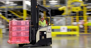 A forklift operator moves a pallet of goods Feb. 13 at a Amazon.com fulfillment center in DuPont, Washington. The Commerce Department reported Friday wholesale stockpiles rose 0.1 percent in August. (AP file photo)
