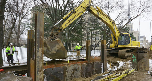 Workers replace a sewer line at near Hennepin Avenue between Vineland Place and Groveland Terrace in this December file photo. The work precedes the Hennepin-Lyndale reconstruction project in the area, which appears to be under budget. (File photo: Bill Klotz)