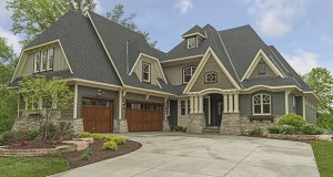 Buyers like big garages, but they can overpower the design of even a large home. New models like this one at 16511 Black Oaks Circle in Minnetonka turn the garage at an angle to the street, keeping the visual focus on the home's entrance. (Submitted photo: Gonyea Homes & Remodeling)