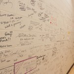 The Wall of Fame signed by numerous guests on TPT's programs over the years.