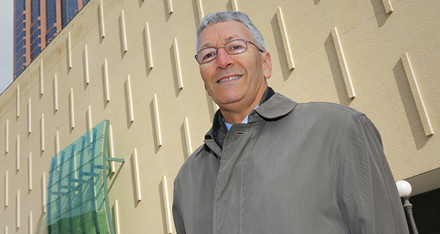 Louis Jambois, who retired from the St. Paul Port Authority in February, stands in front of the former Macy's building in downtown St. Paul. Under his leadership, the authority has been instrumental in redeveloping the store. Staff photo: Bill Klotz