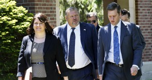 Senate Majority Leader Tom Bakk, center, walks with House Majority Leader Joyce Peppin and House Speaker Kurt Daudt as they arrive at the governor's residence Wednesday in St. Paul to continue negotiating a transportation bill as the legislative session draws to a close. (AP photo: Jim Mone)