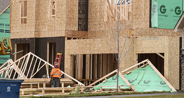 This photo shows a house under construction in October within the Steeple Hills development by Hanson Homes in Plymouth. Permits for single-family homes in the Twin Cities metro area jumped in June. (Staff photo: Bill Klotz)