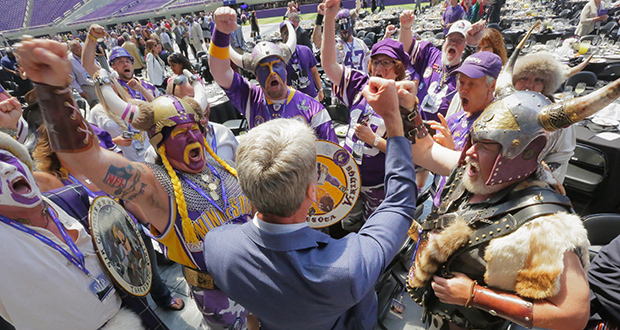 Former Minneapolis Mayor R.T. Rybak talks to hardcore Viking fans after a ribbon-cutting ceremony at U.S. Bank Stadium on Friday. State, Minneapolis and Minnesota Vikings officials celebrated at the event with more than 1,000 people inside the stadium. (Staff photo: Bill Klotz)
