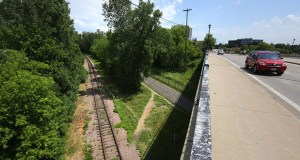The Hennepin County Regional Railroad Authority is transferring to the Metropolitan Council a 2-mile stretch of land next to a set of railroad tracks used by Twin Cities & Western Railroad Company. This photo shows the area just north of the Lake Street bridge over the Kenilworth Trail. (Staff photo: Bill Klotz)