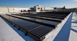 Solar panels manufactured by SunPower Corp. draw energy from the sun Nov. 19, 2009 on the roof of Agilent Technologies Inc.'s headquarters in Santa Clara, California. SunPower said Tuesday it plans to focus more on rooftop power. (Bloomberg file photo)
