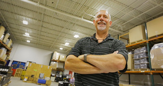 Chuck Welle, owner of Opportunity Distributing Inc. in Minnetonka, replaced the old sodium vapor lights in his facility with LED lights, significantly reducing power consumption. (Staff photo: Bill Klotz)