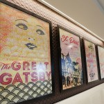 Poster-sized book covers adorn the walls in the F. Scott Fitzgerald board room.
