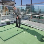 Tom Montminy, managing partner of PwC's Minneapolis market, spends some time on the casual deck's putting green. The deck also features foosball and a ping-pong table.