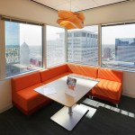 Corner spaces are used as collaborative areas rather than offices.