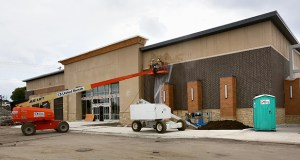 Crews continue work Thursday at Central Park Commons in Eagan, where a new Total Wine & More (pictured) is set to open in November. (Staff photo: Bill Klotz)