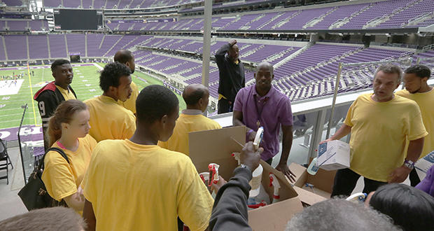 A cleaning crew gets busy Friday inside the U.S. Bank Stadium in Minneapolis, which will host its first major football game of the season between the Vikings and Green Bay Packers on Sunday. (Staff photo: Bill Klotz)