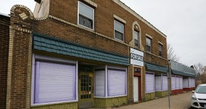 The city-owned property at 4146 Fremont Ave. N. in Minneapolis is set to be sold for $1 to a willing developer. Neighbors and the city would like to see the 1920s-era commercial property renovated and reused. (Staff photo: Bill Klotz)