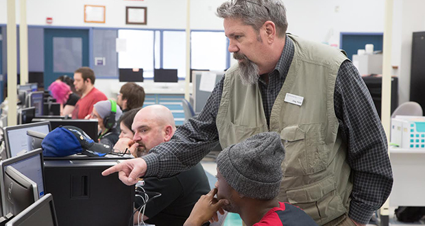 Students must learn about more than computer skills to be successful in cybersecurity, a major where numbers are still low, said Greg Porter, an instructor at Oklahoma City's Francis Tuttle Technology Center.  (Photo: Brent Fuchs/Journal Record)