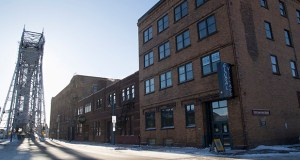 The office buildings at 501 and 525 Lake Ave. S. in Duluth, Minnesota's Canal Park, built a century ago as a wholesale grocery warehouse, have sold for a total of $7 million in two sales between private investors. (Submitted photo: Ron Brochu/BusinessNorth)
