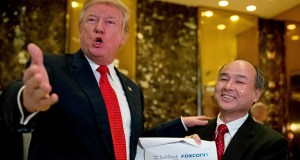 President-elect Donald Trump, left, accompanied by SoftBank CEO Masayoshi Son, speaks on Dec. 6 to members of the media at Trump Tower in New York. Trump talked up Japanese mogul Son, who after meeting with the president-elect in New York, spotlighted his plan to invest $50 billion and create 50,000 jobs. (AP file photo)