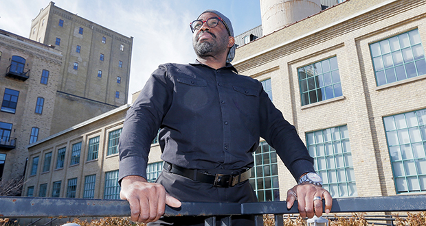 "Mohammed Lawal, principal architect/CEO of LSE Architects in Minneapolis, works out of this office at 100 Portland Ave. in Minneapolis. He has ""all qualities that make an architect successful,"" says one of his former architecture instructors. (Staff photo: Bill Klotz)"