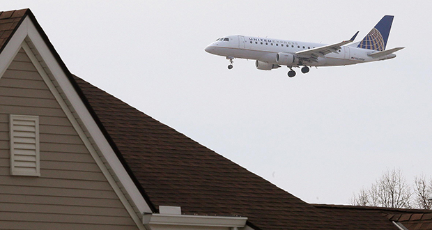 The Metropolitan Airports Commission says 138 single-family and 88 multifamily housing units, all in Minneapolis, are eligible for the improvements this year as part of its noise mitigation program. This photo, taken Monday, shows a plane over south Minneapolis on its approach to the airport. (Staff photo: Bill Klotz)
