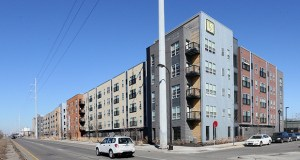 """Sherman Associates will break ground on a """"solar garden"""" this spring to offset power usage at its Hennepin County properties, including the Longfellow Station Apartments (above) at 3845 Hiawatha Ave. in Minneapolis. (Staff photo: Bill Klotz)"""