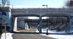 This century-old Portland Avenue bridge over the Midtown Greenway in Minneapolis will be reconstructed this summer along with the Cedar Avenue bridge. Twenty-six bridges over the greenway are at varying stages of disrepair. (Photo: Craig Lassig)