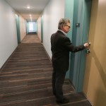 Executive Director for J-HAP Jeff Sherman opens the door to a two bedroom unit on the first floor.